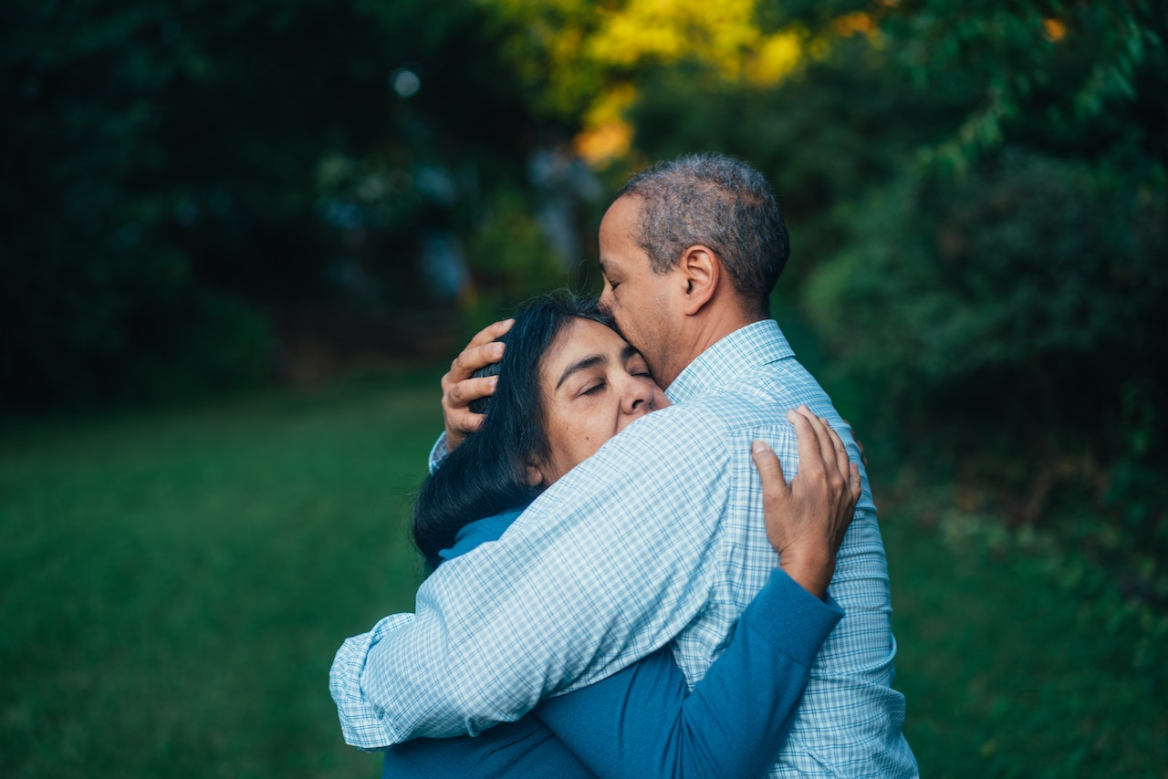 Couple holding each other, physical diseases