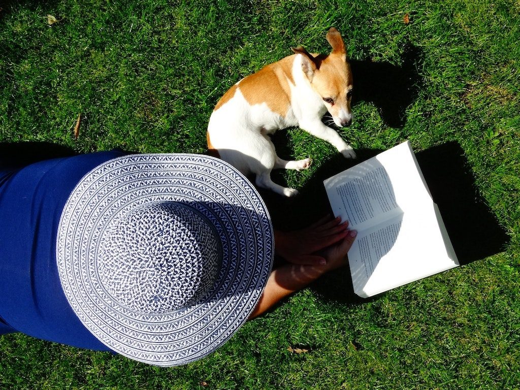 Woman with Dog Outside, Summer Reading List